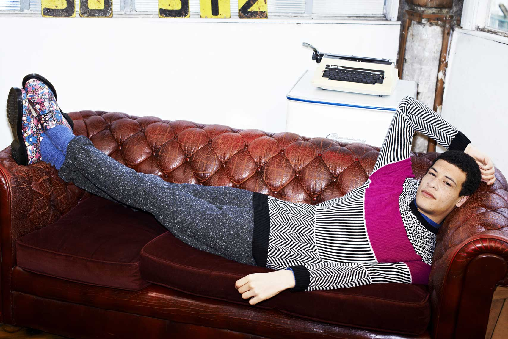 issie-gibbons-fashion-stylist-urban-knit-menswear-campaign-warehouse-leather-sofa